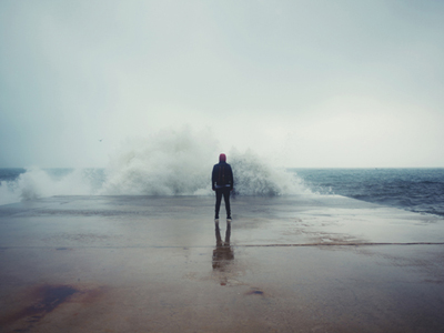 Man Standing Against Wave
