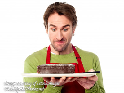 Chef Holding Chocolate Cake