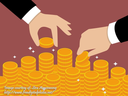 Gold Coins with Business Hands